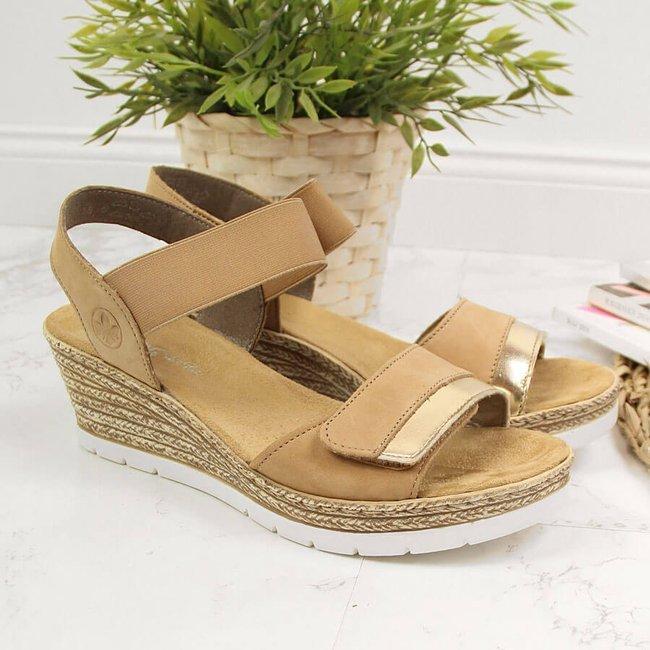 Sandały skórzane damskie na koturnie beżowe Rieker 61940